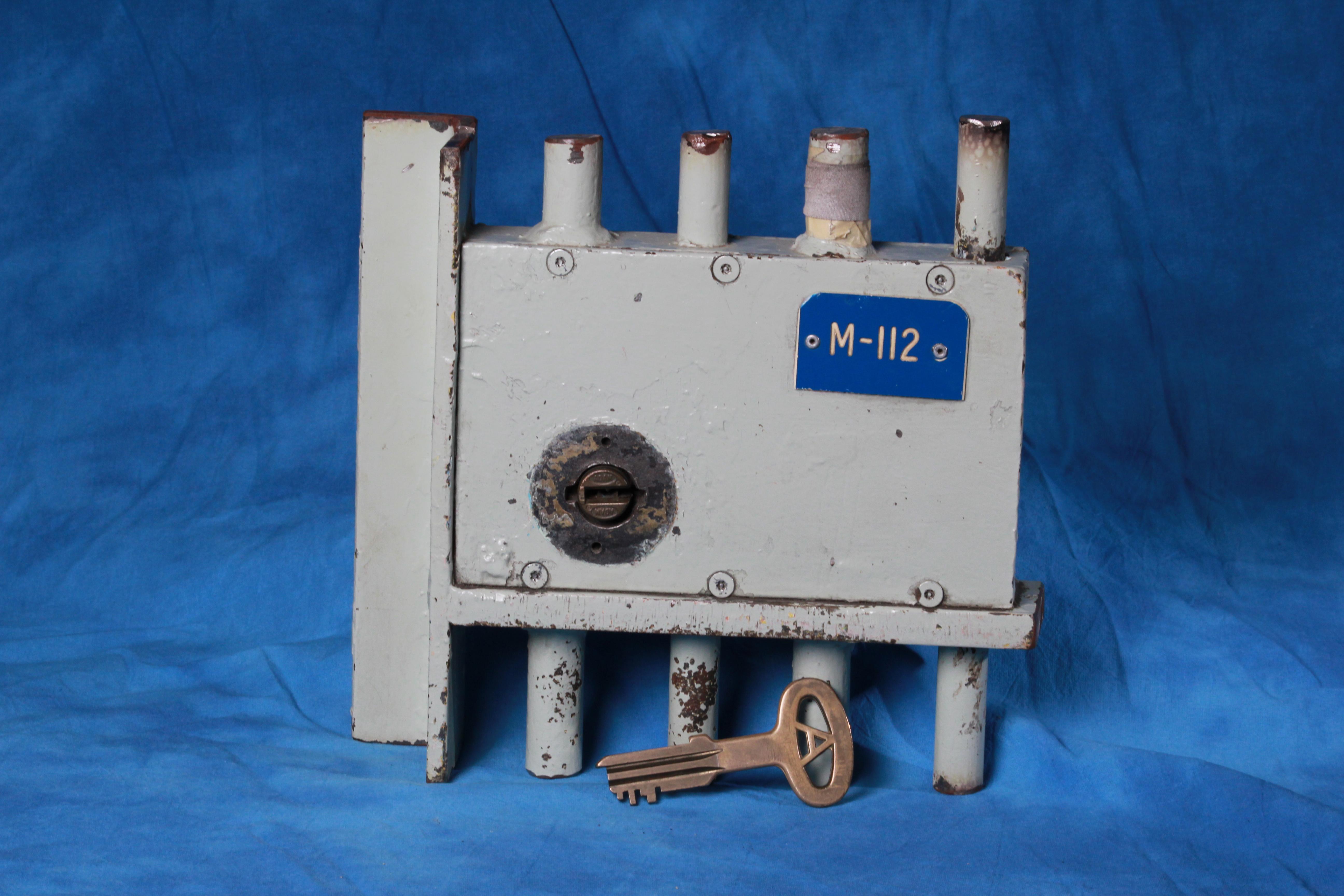 Lock and key cut from Oak Ridge gate