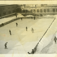 Patients skating and playing hockey on rink in yard
