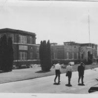 Oak Ridge, front entrance, three men walking, 1970s.jpg