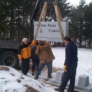 Laying the Asylum Point Cemetery stone