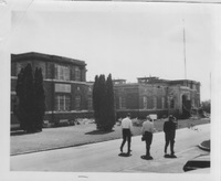 Oak Ridge, front entrance, three men walking, 1970s.jpg