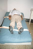 1988_July_Bed restraints with person 2.jpg